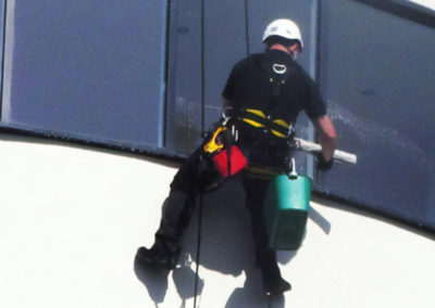 Commercial window cleaning of office block via rope access