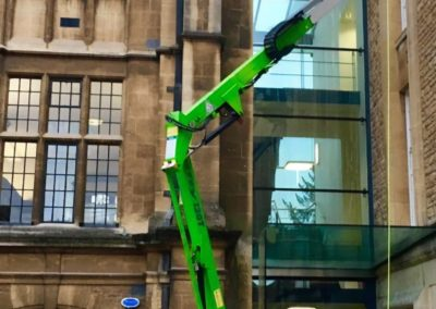 High level window cleaning via cradle system